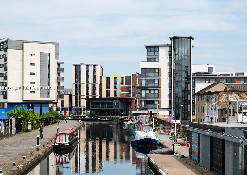 View of Union Canal at Lochrin Basin with modern new apartment buildings  at Fountainbridge in Edinburgh, Scotland, United Kingdom, UK