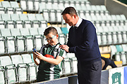 Plymouth Argyle manager Derek Adams has a selfie with a young fan before the EFL Sky Bet League 1 match between Plymouth Argyle and Burton Albion at Home Park, Plymouth, England on 20 October 2018.