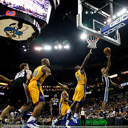 January 22, 2011; New Orleans, LA, USA; San Antonio Spurs point guard Tony Parker (9) shoots over New Orleans Hornets center Emeka Okafor (50) during the first half at the New Orleans Arena.   Mandatory Credit: Derick E. Hingle