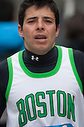 A runner showing a basket Boston shirt remembering victims of Boston attacks
