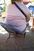 obese woman sitting in an chair