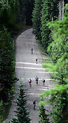 SHOT 8/19/11 9:21:03 AM - A group of racers climb a long hill on Boreas Pass Road during the final day of racing in The Breck Epic in Breckenridge, Co. The event is a 6-day ultra-endurance mountain bike stage race held in the sprawling backcountry surrounding the town of Breckenridge, Co. The course is 240 miles and features a combined 38,000 feet of climbing, 90% of which is above 10,000 feet. More than 200 riders from 15 different countries participated in the race. (Photo by Marc Piscotty / © 2011)