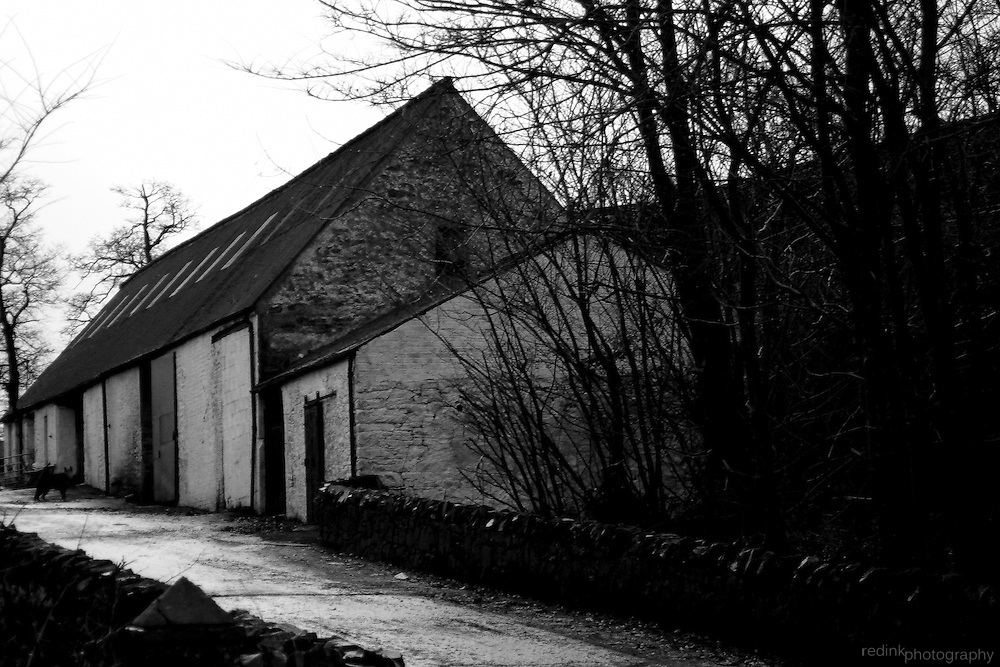 Small white cottage/house alongside the road to Stirling, Scotland.