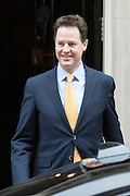 © London News Pictures. 30/03/2015 . British prime minister DAVID CAMERON and deputy prime minister NICK CLEGG leave Number 10 Downing Street in London to travel to Buckingham Palace to inform the Queen of the dissolution of Parliament ahead of the general election. Photo credit : Stephen Simpson/LNP