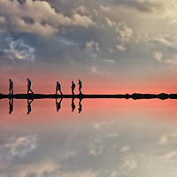 Conceptual beach scene with five adults in silhouette