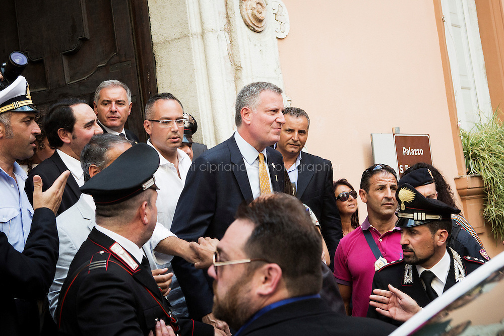 SANT'AGATA DE GOTI, ITALY - 23 JULY 2014: Mayor of New York Bill De Blasio steps out the city hall of Sant'Agata de Goti, his ancestral home town in Italy, on July 23rd 2014.<br /> <br /> New York City Mayor Bill de Blasio arrived in Italy with his family Sunday morning for an 8-day summer vacation that includes meetings with government officials and sightseeing in his ancestral homeland.