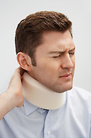 Man wearing neck brace in hospital