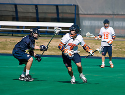 Virginia attackman Danny Glading (9) in action against Navy defenseman Andrew Thorp (49).  The Virginia Cavaliers scrimmaged the Navy Midshipmen in lacrosse at the University Hall Turf Field  in Charlottesville, VA on February 2, 2008.