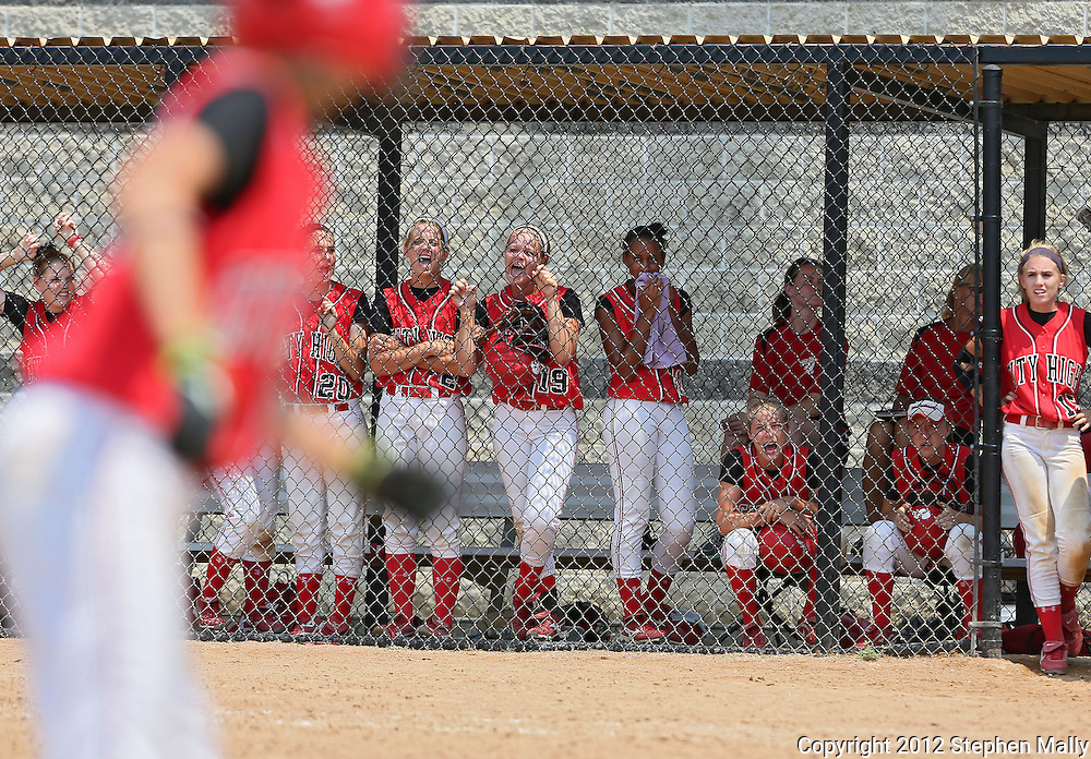 City High's Caitlyn Jones (foreground), who represents the tying run, is cheered on by her teammates in the bottom of the 7th inning of the game between West Liberty and Iowa City High in the 25th Annual Iowa City West Softball Classic at the University of Iowa Softball Complex in Iowa City on Saturday afternoon, June 30, 2012. City High scored five runs in the bottom of the 7th inning to defeat West Liberty 6-5.