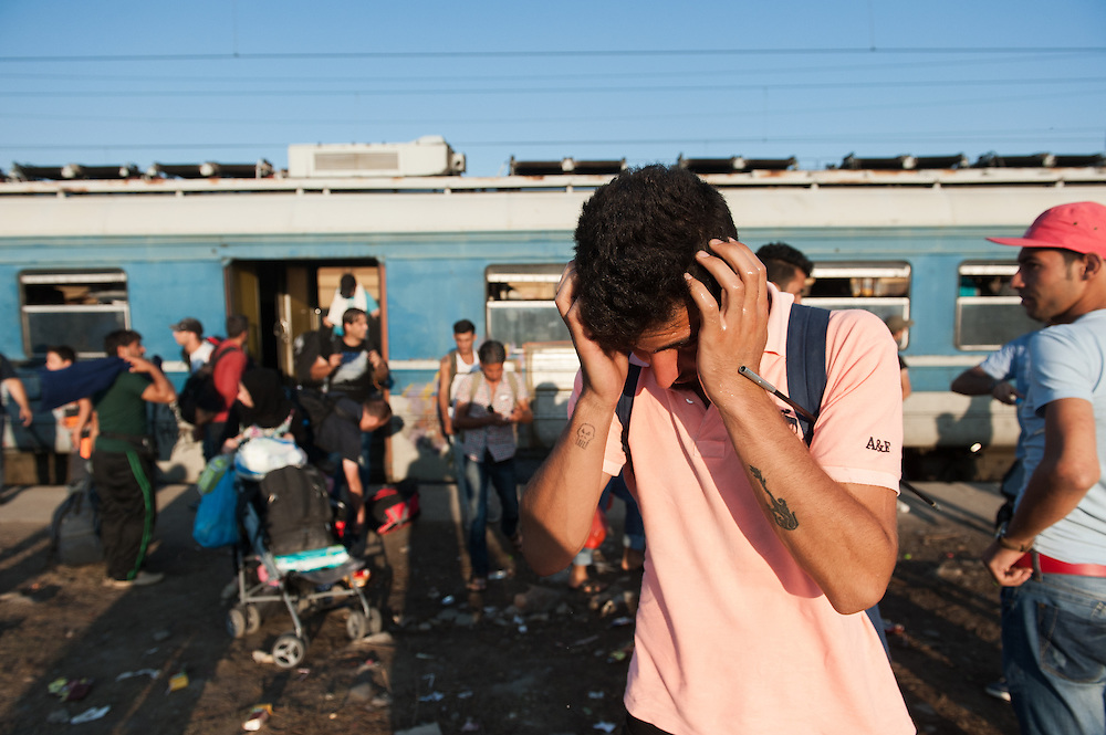Sunday 13th of September 2015. A Kurdish man is washing his face minutes after he alight from the Gevgelija to Slanishte train in the Republic of Macedonia.