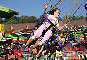 An unidentified young girl takes a spin on one of the many carnival rides at the Maryland State Fair Saturday, September 4, 2010 in Timonium, MD.
