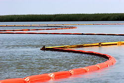 05 May 2010. Venice, Louisiana. Deepwater Horizon, British Petroleum environmental oil spill disaster.<br /> Oil containment booms stretch out through the ecologically sensitive wetlands and marshes of Plaquemines parish in an effort to prevent oil from killing the marshes.<br /> Photo credit; Charlie Varley/varleypix.com