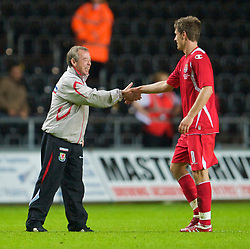 SWANSEA, ENGLAND - Friday, September 4, 2009: Wales' manager Brian Flynn celebrates with goal-scorer and man-of-the-match Aaron Ramsey after beating Italy 2-1 during the UEFA Under 21 Championship Qualifying Group 3 match at the Liberty Stadium. (Photo by David Rawcliffe/Propaganda)