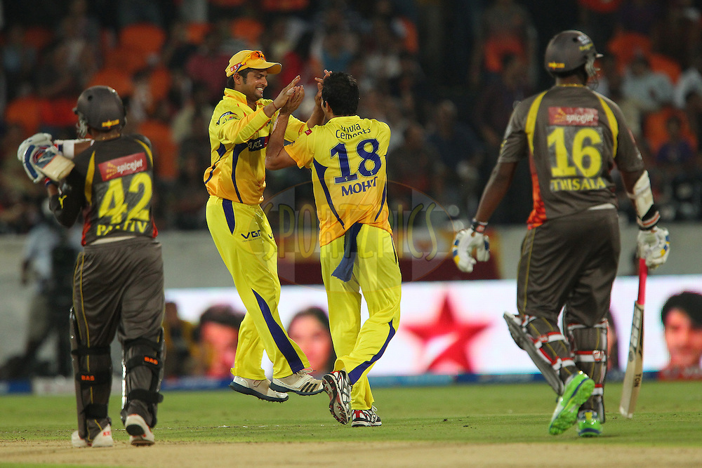 Suresh Raina and Mohit Sharma celebrate the wicket of Parthiv Patel during match 54 of the Pepsi Indian Premier League between The Sunrisers Hyderabad and Chennai Superkings held at the Rajiv Gandhi International  Stadium, Hyderabad  on the 8th May 2013..Photo by Ron Gaunt-IPL-SPORTZPICS ..Use of this image is subject to the terms and conditions as outlined by the BCCI. These terms can be found by following this link:..http://www.sportzpics.co.za/image/I0000SoRagM2cIEc