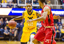 Dec 10, 2016; Morgantown, WV, USA; West Virginia Mountaineers guard Tarik Phillip (12) drives down the lane during the first half against the Virginia Military Keydets at WVU Coliseum. Mandatory Credit: Ben Queen-USA TODAY Sports