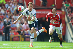 MANCHESTER, ENGLAND - Saturday, August 8, 2015: Tottenham Hotspur's captain Jan Vertonghen in action against Manchester United's captain Wayne Rooney during the Premier League match at Old Trafford. (Pic by David Rawcliffe/Propaganda)