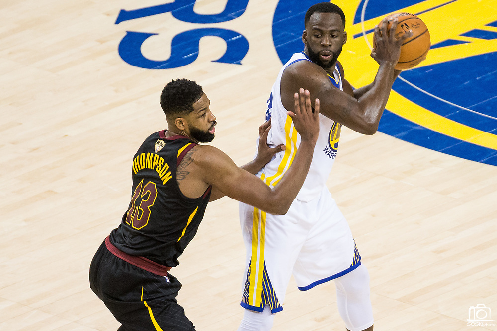 Golden State Warriors forward Draymond Green (23) holds the ball against the Cleveland Cavaliers during Game 1 of the NBA Finals at Oracle Arena in Oakland, Calif., on May 31, 2018. (Stan Olszewski/Special to S.F. Examiner)