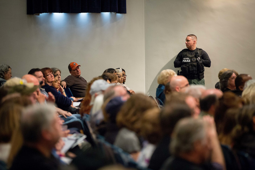 Sgt. Josh Liedke, of the Marietta Police Department, observes the crowd during the Civilian Response To Active Shooter Events training at Marietta Middle School in Marietta, Ga. on Sunday, Dec. 20, 2015. The event, free to the public, was put on by the MPD. About 700 showed up. Photo by Kevin D. Liles for The Wall Street Journal