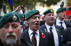 © Licensed to London News Pictures. 28/10/2015. London, UK. Veteran Royal Marines shout support outside Downing Street during a rally calling for Sgt Alexander Blackman to be released.  Sgt Blackman was sentence for killing a Talliban insurgent in Afghanistan in 2011. He was convicted of murder at a court martial in 2013.   Photo credit: Peter Macdiarmid/LNP