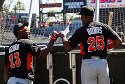 SAN FRANCISCO, CA - APRIL 24: Barry Bonds #25 of the Miami Marlins fist bumps Marcell Ozuna #13 during batting practice before the game against the San Francisco Giants at AT&T Park on April 24, 2016 in San Francisco, California.  The Miami Marlins defeated the San Francisco Giants 5-4. (Photo by Jason O. Watson/Getty Images) *** Local Caption *** Barry Bonds; Marcell Ozuna