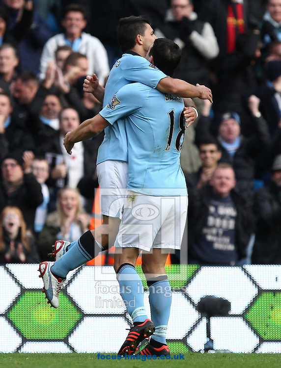 Picture by John  Rainford/Focus Images Ltd +44 7506 538356.11/11/2012.Sergio Aguero and Gareth Barry of Manchester City celebrate the equaliser during the Barclays Premier League match at the Etihad Stadium, Manchester.