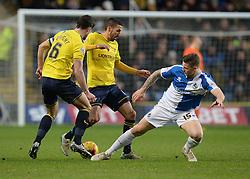 James Clarke of Bristol Rovers tackles Jake Wright of Oxford United - Mandatory byline: Alex James/JMP - 17/01/2016 - FOOTBALL - The Kassam Stadium - Oxford, England - Oxford United v Bristol Rovers - Sky Bet League Two