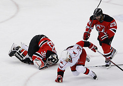 Apr 23, 2009; Newark, NJ, USA; New Jersey Devils goalie Martin Brodeur (30) lies on the ice after being hit by Carolina Hurricanes right wing Chad LaRose (59) during the first period of game five of the eastern conference quarterfinals of the 2009 Stanley Cup playoffs at the Prudential Center.
