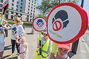 Families support the No2 dirtry air campaign and legal challenge to the government - A perfect summers day for the Campaign against Climate Change's backwards march – on the governments first anniversary in power the protestestors  wanted to highlight their belief that clean energy technology has been sidelined in favour of a 'dash for gas, insulation cut and fracking, roads and runways pushed through despite strong local opposition'. They walked backwards from Traflagar Square, down Whitehall, ending at the DoH.