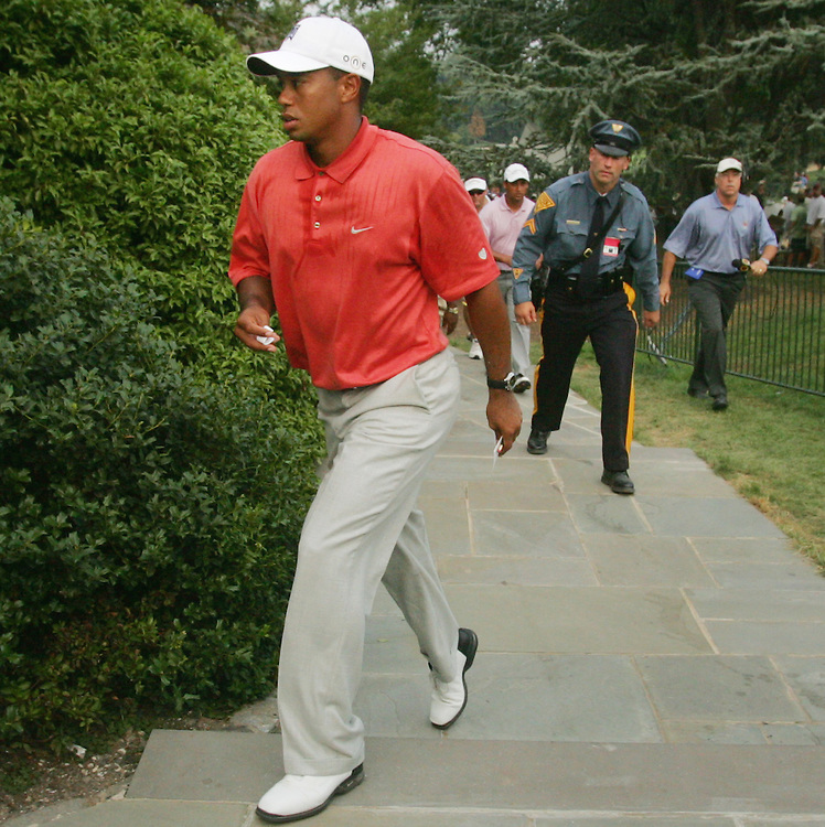 Tiger Woods of the US walks up to the clubhouse after completing the second round of the 2005 PGA Championship with 4 strokes over par at Baltusrol Golf Club in Springfield, New Jersey, Friday 12 August 2005. Woods just made the cut for the next round by scoring a birdie on the 18th hole.