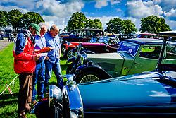 The 44th Biggar Vintage Vehicle Rally held in Biggar on 13th August 2017.  People admiring the vehicles.<br /> <br /> (c) Andrew Wilson | Edinburgh Elite media