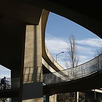 A cyclist makes his way up the ramp towards the Marion Street Bridge from Riverfront Park on Thursday, Jan. 12, 2012.