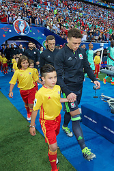 LYON, FRANCE - Wednesday, July 6, 2016: Wales' James Chester walks out to face Portugal before the UEFA Euro 2016 Championship Semi-Final match at the Stade de Lyon. (Pic by David Rawcliffe/Propaganda)