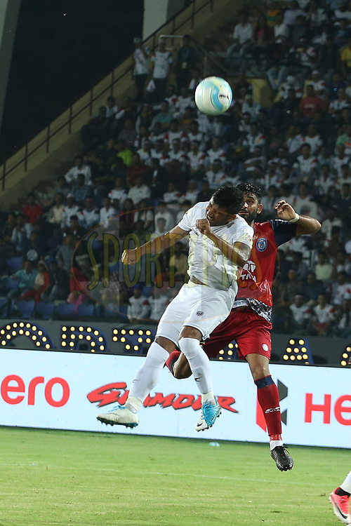 Anas Edathodika of Jamshedpur FC  and Nirmal Chettri of Northeast United FC during match 2 of the Hero Indian Super League between NorthEast United FC and Jamshedpur FC held at the Indira Gandhi Athletic Stadium, Guwahati India on the 18th November 2017<br /> <br /> Photo by: Ron Gaunt / ISL / SPORTZPICS