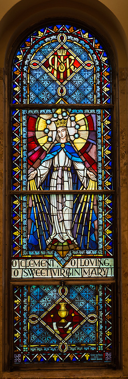 Stained glass image of Mary with words from Hail, Holy Queen prayer. (Sam Lucero photo)