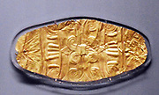 Gold mouth plate for a dead person to be entombed with. It depicts the tree of life. Greek, Mycenaean 800-700 BC