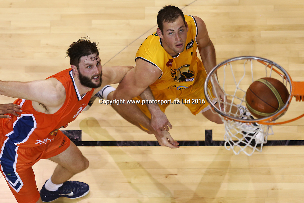 Alex Pledger of the Sharks (L) and Daniel Miller of the Mountainairs compete for the ball in the NBL basketball match between the Southland Sharks and Taranaki Mountainairs, ILT Stadium Southland, Invercargill, Saturday, March 19, 2016. Photo: Dianne Manson / www.photosport.nz