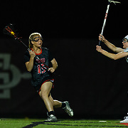 23 March 2018: San Diego State Aztecs midfielder Taylor Sullivan looks to pass the ball in the first half. The Aztecs beat the Lady Flames 11-10 Friday night. <br /> More game action at sdsuaztecphotos.com