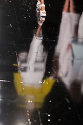 © Licensed to London News Pictures. 05/06/2013. London, England. Reflection of a model on the catwalk during the Gala Show at Earl's Court 2. Graduate Fashion Week 2013 showcasing student collections took place at Earl's Court II from 2 to 5 June 2013. Photo credit: Bettina Strenske/LNP