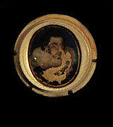 Miniature portrait, water-colours on vellum, ivory and glass.  Late 1500s early 1600s, unprovenanced.  This is a portrait of a young man by Nicholas Hilliard.  Hilliard was the founder of the British School of miniature painting and was miniaturist to Queen Elizabeth 1