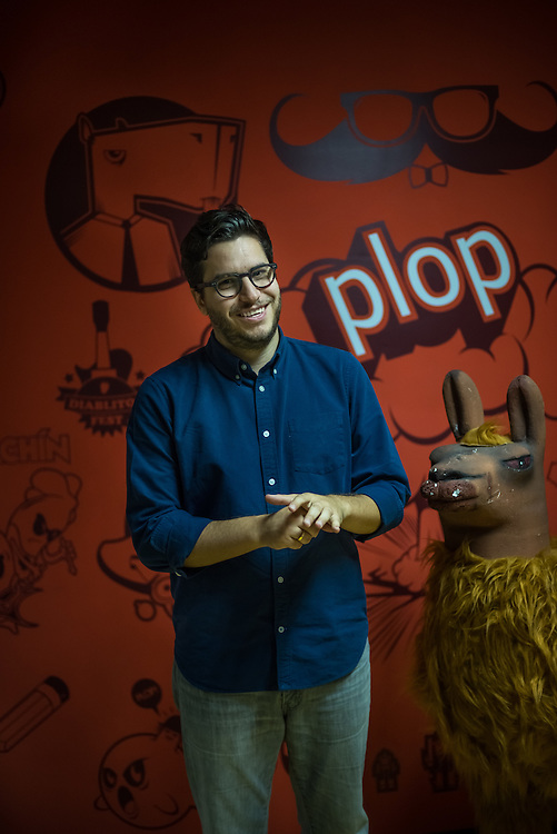 CARACAS, VENEZUELA - MAY 6, 2015:  Juan Andrés Ravell, one of the creators of the Web site El Chigüire Bipolar, or Bipolar Capybara, poses for a portrait at his office in Caracas, Venezuela. His website, www.elchiguirebipolar.net, is commonly referred to as Venezuela's version of www.theonion.com.  PHOTO: Meridith Kohut for Buzzfeed News