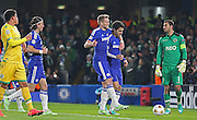 Chelsea's Cesc Fàbregas scores from the penalty spot during the UEFA Champions League match between Chelsea and Sporting Lisbon at Stamford Bridge, London, England on 10 December 2014.