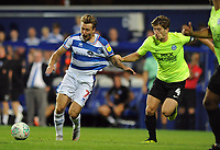 Football - 2018 / 2019 EFL Carabao Cup (League) Cup - Queens Park Rangers vs. Peterborough United<br /> <br /> Luke Freeman of QPR has his shirt pulled by Alex Woodyard, at Loftus Road.<br /> <br /> COLORSPORT/ANDREW COWIE