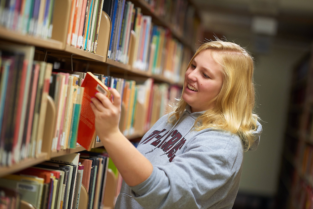 UWL UW-L UW-La Crosse University of Wisconsin-La Crosse; Activity; Studying; Buildings; Murphy Library; People; Student Students; Time/Weather; day; Winter; December; Objects; Books; Type of Photography; Candid; Lifestyle; Woman Women