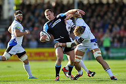 Chris Fusaro of Glasgow Warriors is tackled by Dominic Day of Bath Rugby - Photo mandatory by-line: Patrick Khachfe/JMP - Mobile: 07966 386802 18/10/2014 - SPORT - RUGBY UNION - Glasgow - Scotstoun Stadium - Glasgow Warriors v Bath Rugby - European Rugby Champions Cup