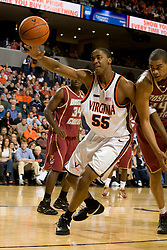 Virginia forward/center Jerome Meyinsse (55) lunges for a loose ball.  The Virginia Cavaliers men's basketball team defeated the Boston College Golden Eagles 84-66 at the John Paul Jones Arena in Charlottesville, VA on January 19, 2008.