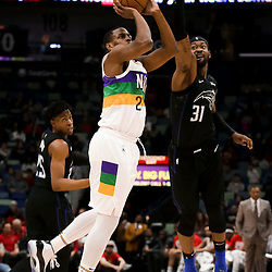 Feb 12, 2019; New Orleans, LA, USA; New Orleans Pelicans forward Darius Miller (21) shoots over Orlando Magic guard Terrence Ross (31) during the second half at the Smoothie King Center. Mandatory Credit: Derick E. Hingle-USA TODAY Sports