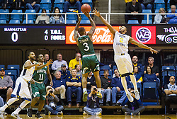 Nov 28, 2016; Morgantown, WV, USA; Manhattan Jaspers guard Zavier Turner (3) shoots a three pointer over West Virginia Mountaineers guard Jevon Carter (2) during the first half at WVU Coliseum. Mandatory Credit: Ben Queen-USA TODAY Sports