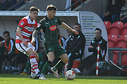 Plymouth Argyle midfielder Matthew Kennedy (16) and Conor Grant (25) of Doncaster Rovers  during the EFL Sky Bet League 2 match between Doncaster Rovers and Plymouth Argyle at the Keepmoat Stadium, Doncaster, England on 26 March 2017. Photo by Ian Lyall.