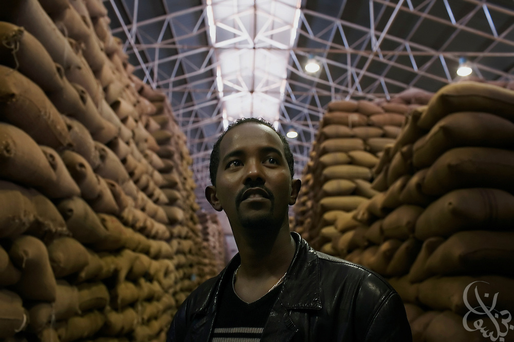 Ashenafi Argaw, export division head for the Sidamo Coffee Farmers Co-operative Union (SCFCU), checks co-op members' coffee supplies at the warehouse of the Keffa Export Coffee Processing Plant February 24, 2007 in Addis Ababa, Ethiopia.  The SCFCU represents the interests of more than 86,000 Ethiopian farmers from 47 cooperatives in the Sidamo region. ..
