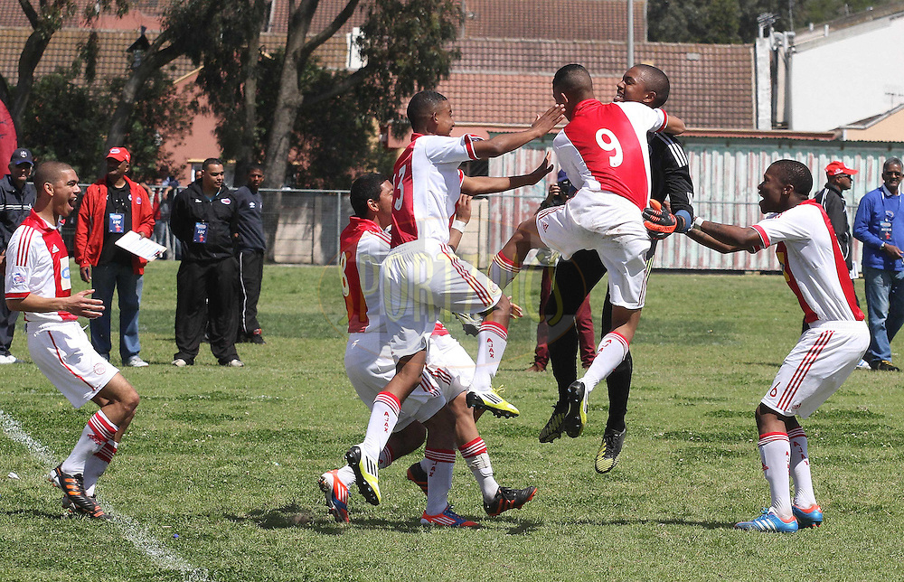 Ajax Cape Town celebrate  after winning the penalty shoot out to reach the final during the semi final on the final day of the Engen Knock Out Challenge held at Stephen Reagan Sports Ground, Mitchells Plain in Cape Town on the 30th September 2012..Photo by Shaun Roy/ SPORTZPICS..